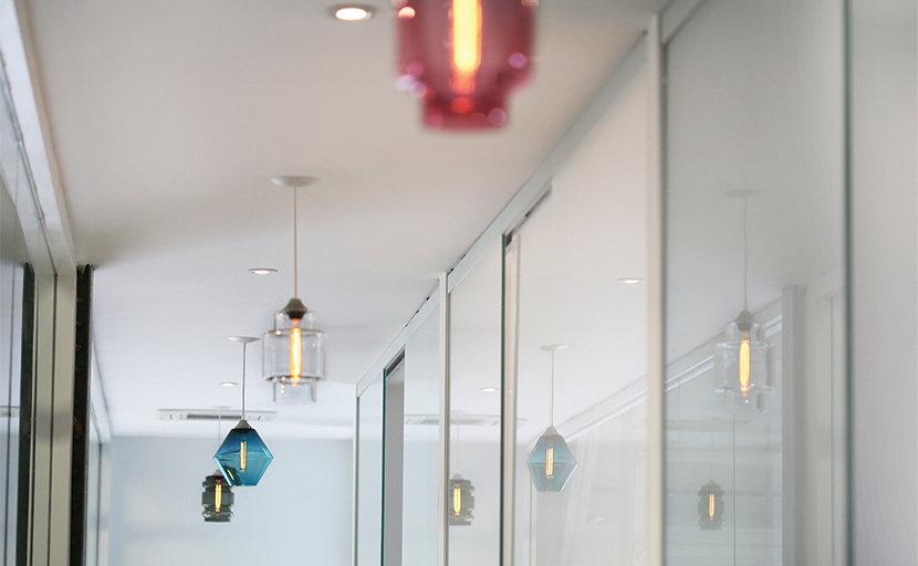modern glass pendant lighting in office