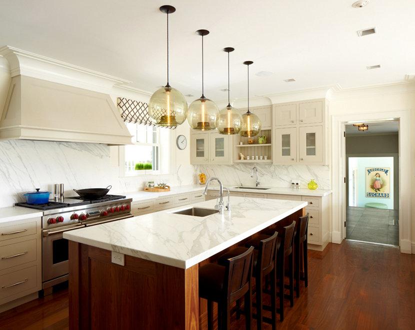 Four Stamen Modern Pendant Lights Hang Above The Kitchen Island