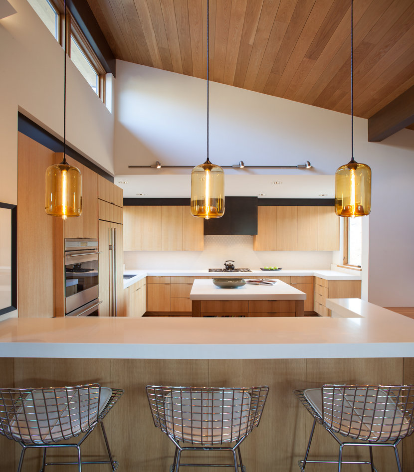 Kitchen Island Pendant Lighting Emits Golden Glow In Sun