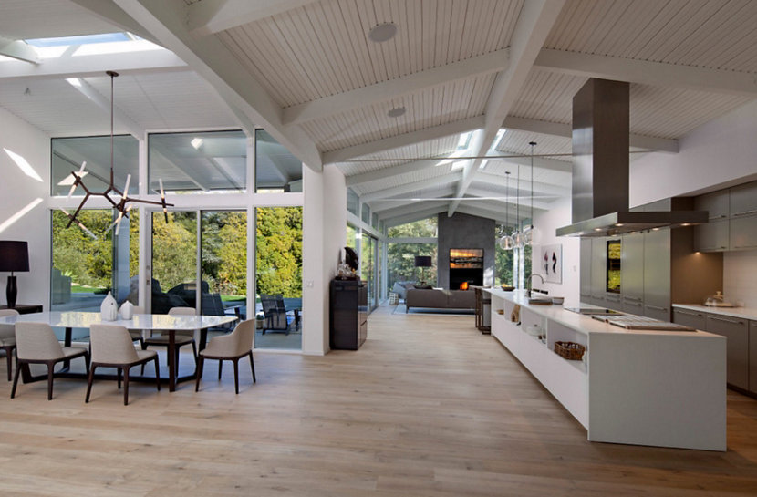 Hand blown glass kitchen island lighting illuminates for California ranch style architecture