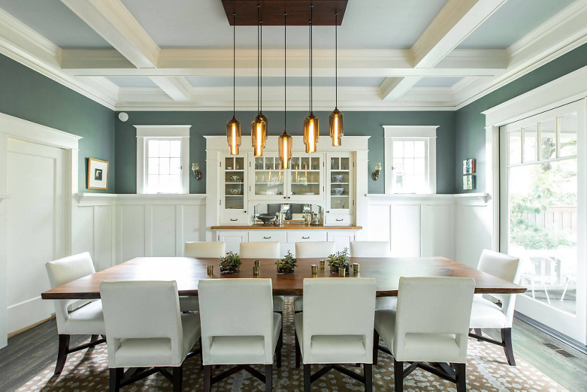 Modern pendant lighting is the spotlight of this dining room