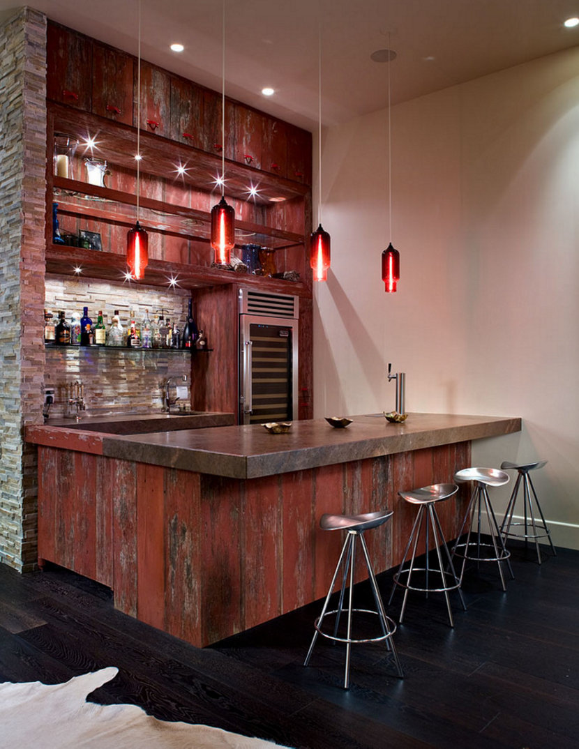Modern pendant lighting makes a bold statement above a bar