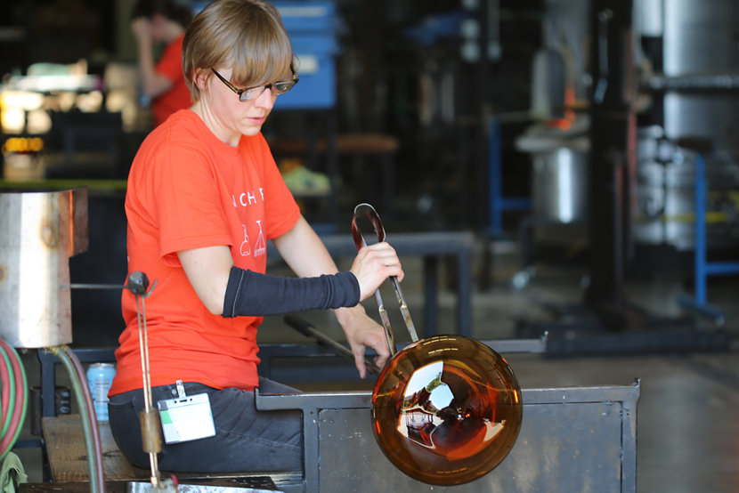 Andrea doing glassblowing demonstrations at our Factory Sale