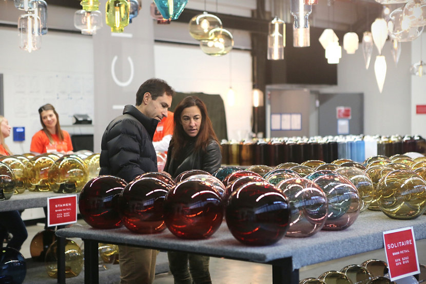 couple admiring glass pendant lighting