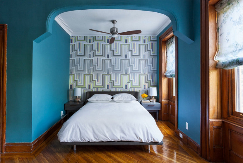 master bedroom with teal painted accent wall