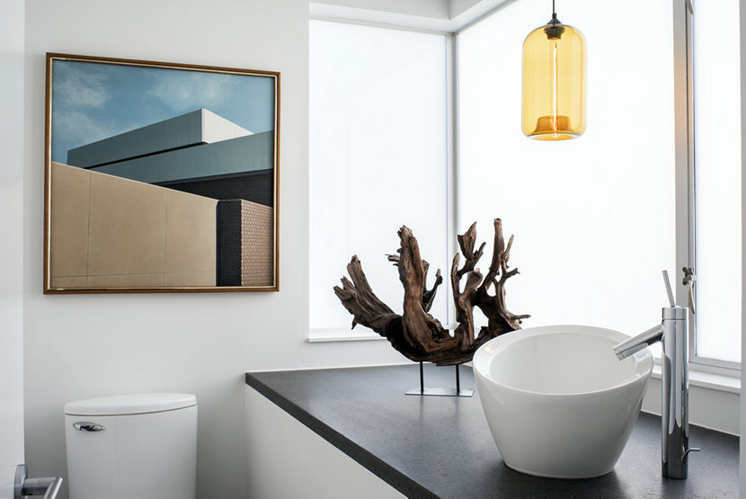 Amber pendant lighting seen in modern bathroom