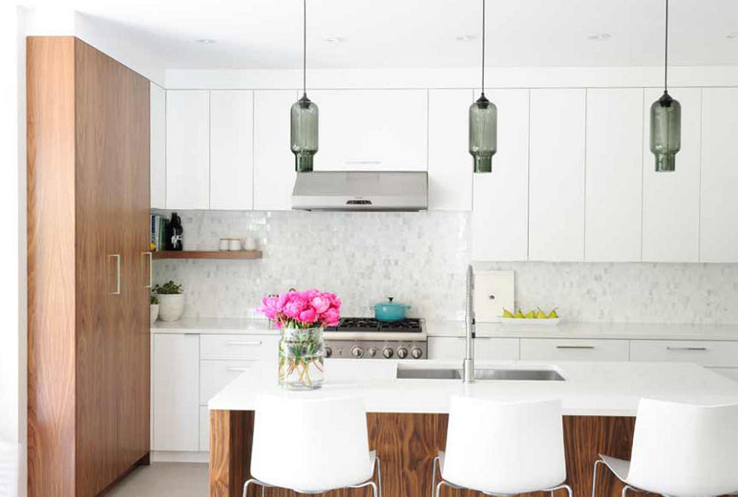 Gray glass pendant lighting above kitchen island