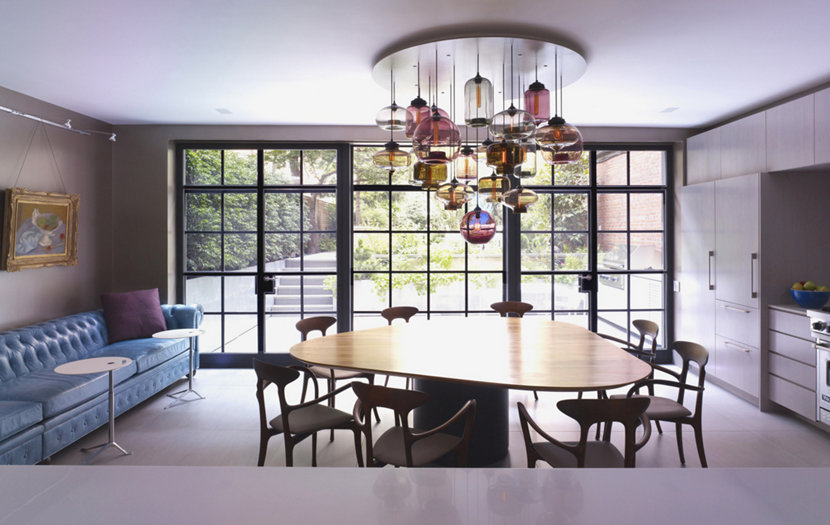 colored glass pendant lighting above table
