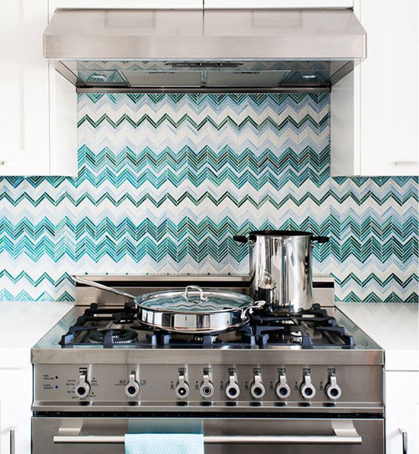 Teal zig zag kitchen backsplash behind stove.