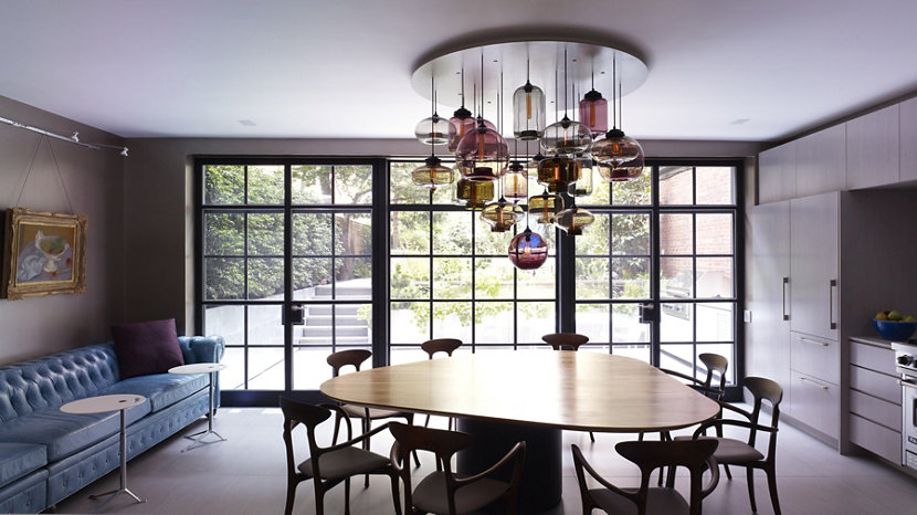 A Cluster Of Multi Pendants Hang From Custom Circular Canopy