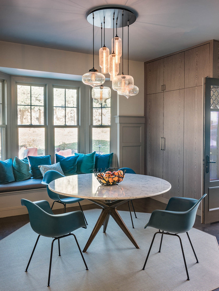 Modern chandelier lighting illuminates massachusetts dining room aloadofball Choice Image