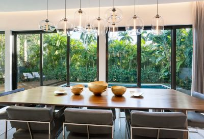 Table Pendant Lighting Makes a Timeless Statement in Modern Beach Home