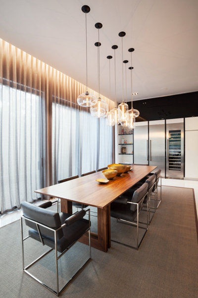 clear glass pendant lighting above table