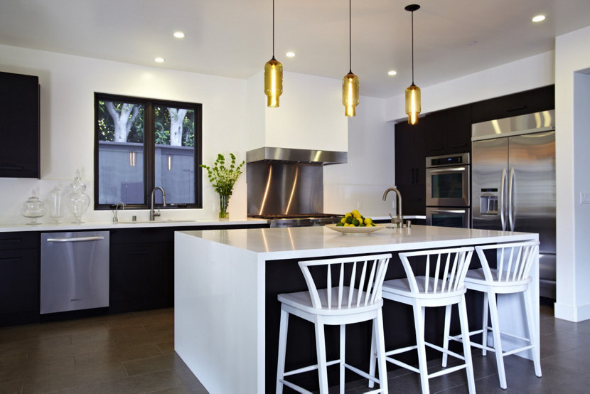 Amber pendant lighting shines bright in modern kitchen