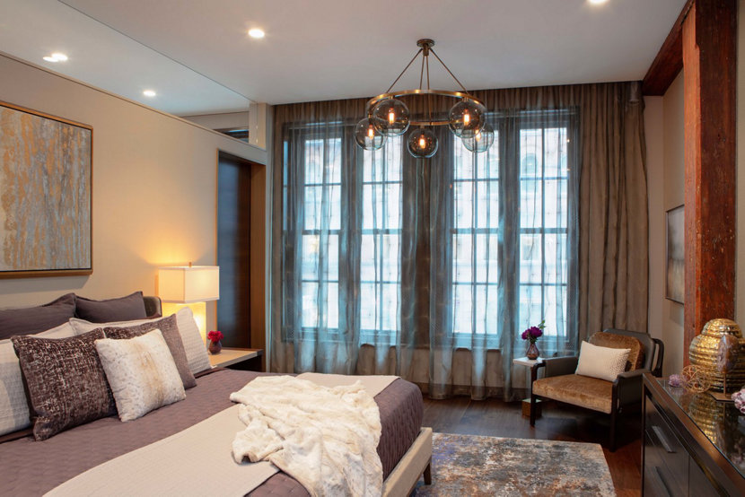 modern bedroom chandelier creates relaxed vibe in new york residence - Bedroom Chandelier