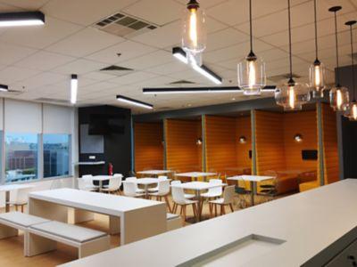 Various Pendant Light Glass Shapes Unite in an Office Breakroom