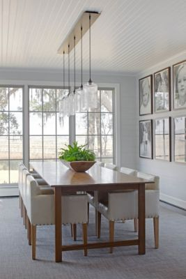 A Ceiling Canopy Creates a Sleek Finish for this Dining Room Pendant