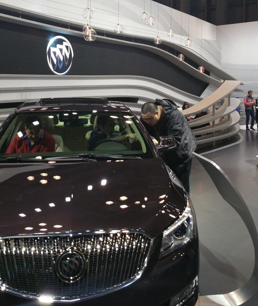 The Buick Lounge at the International Auto Show displays glass pendant lighting.
