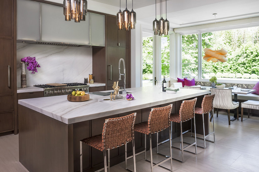 Modern pendant lighting makes a statement above this kitchen island