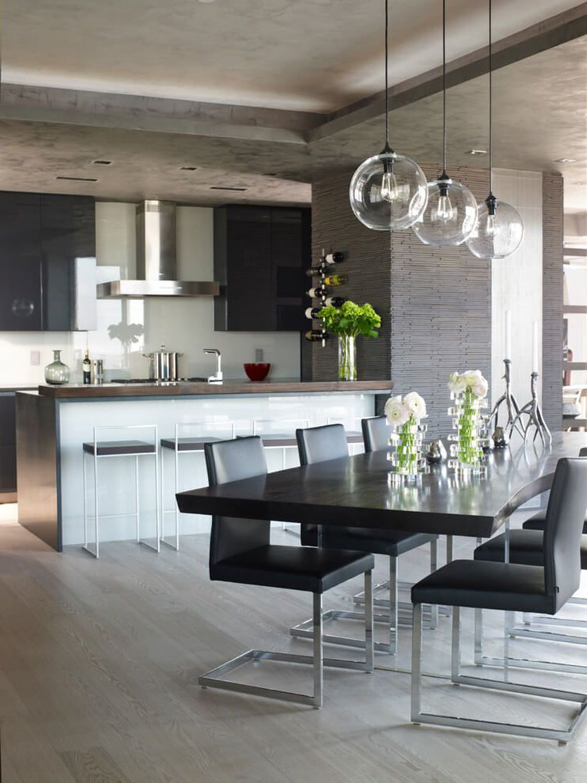 Clear Glass Modern Pendants Over a Dark Wood Dining Table