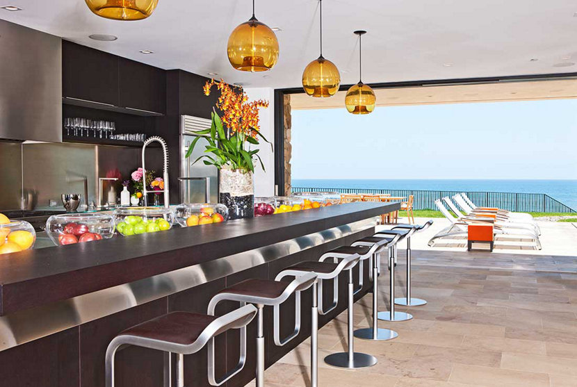 Malibu ocean front home with amber kitchen island pendant lighting