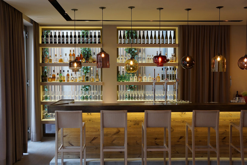 hotel bar with modern glass pendant lighting