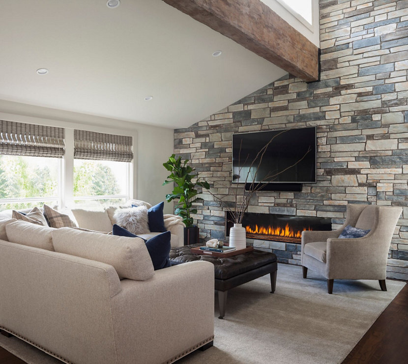 Stone Accent Wall and Natural Color Palette Helps Tie Room Together