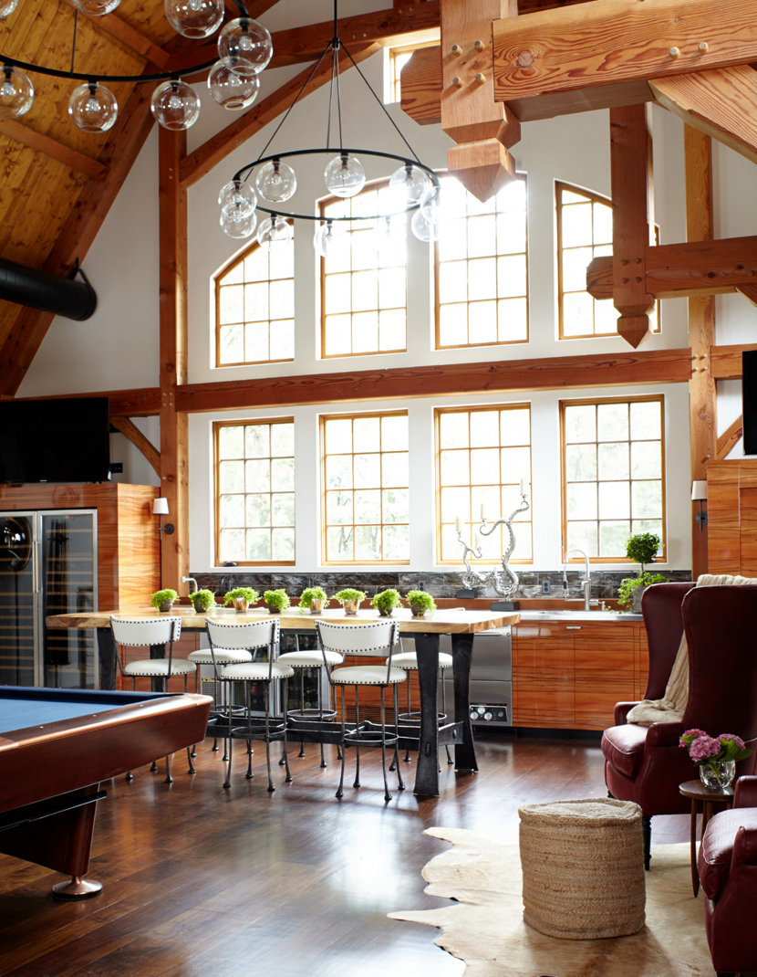 Niche Contemporary Chandeliers Hang in the Barn Loft
