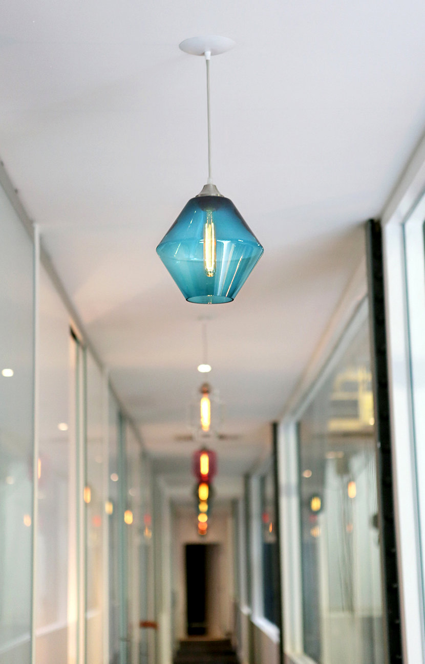 modern glass lighting in office hallway