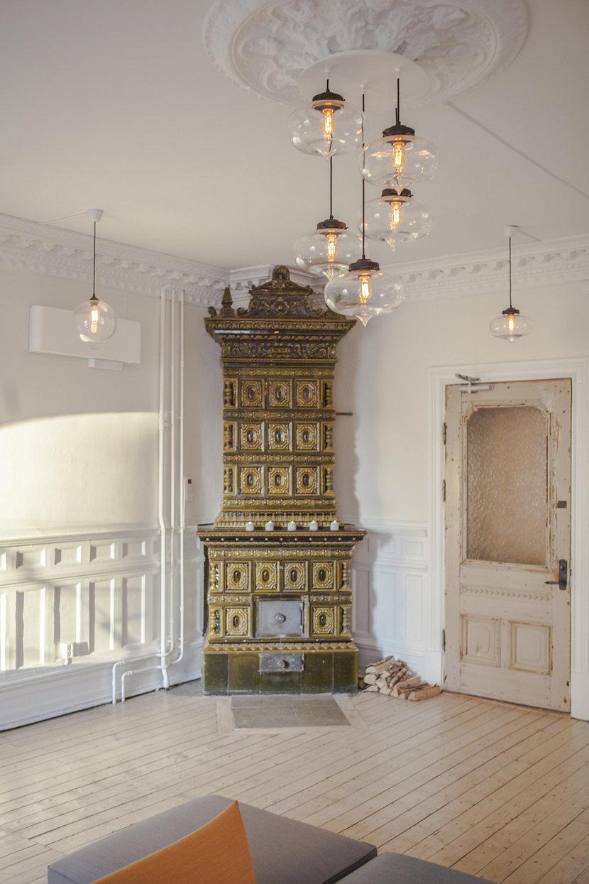 Minaret Modern Pendant Lights Hang From A Contemporary Chandelier