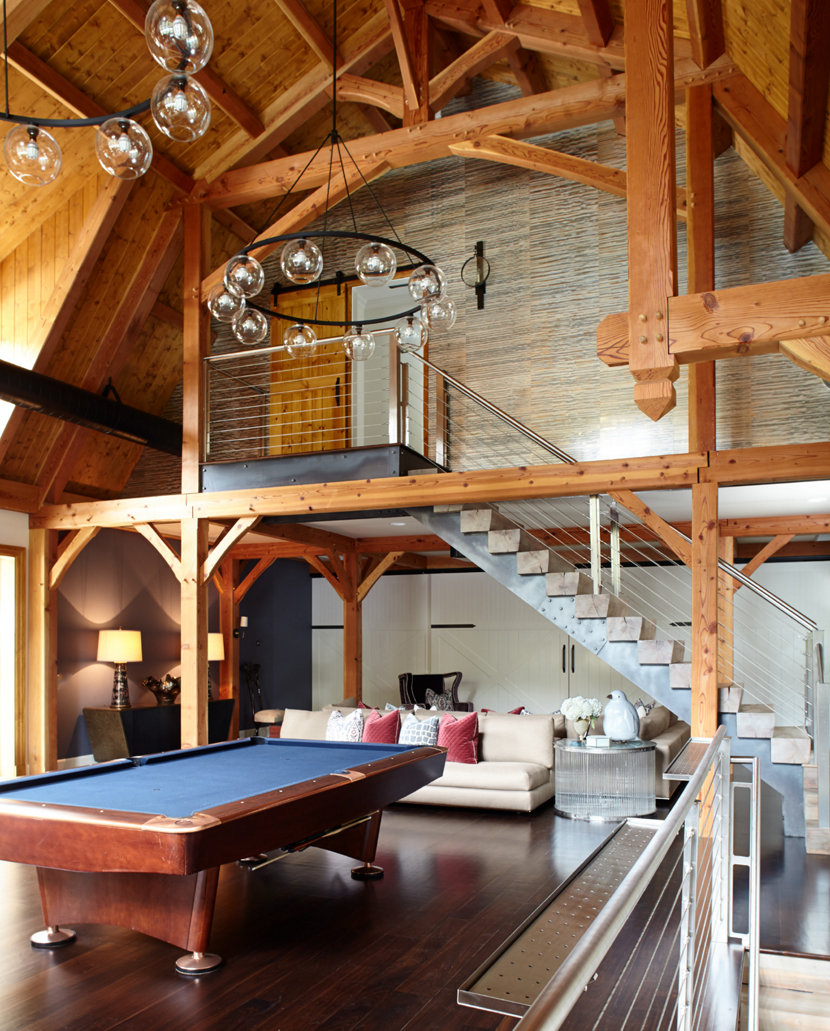 Contemporary Chandeliers Hang Over Billiards Table