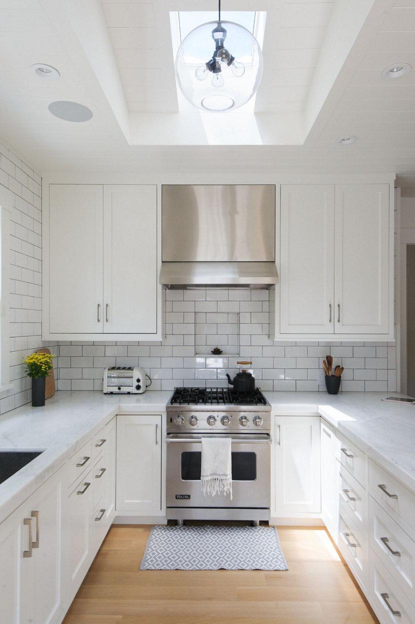 A Single Crystal Terra Pendant Hangs in White Farmhouse Kitchen