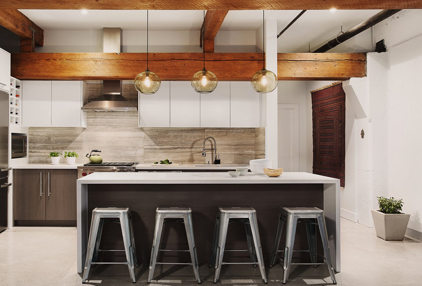 Kitchen island pendant lighting in an urban inspired penthouse for Modern island pendant lighting