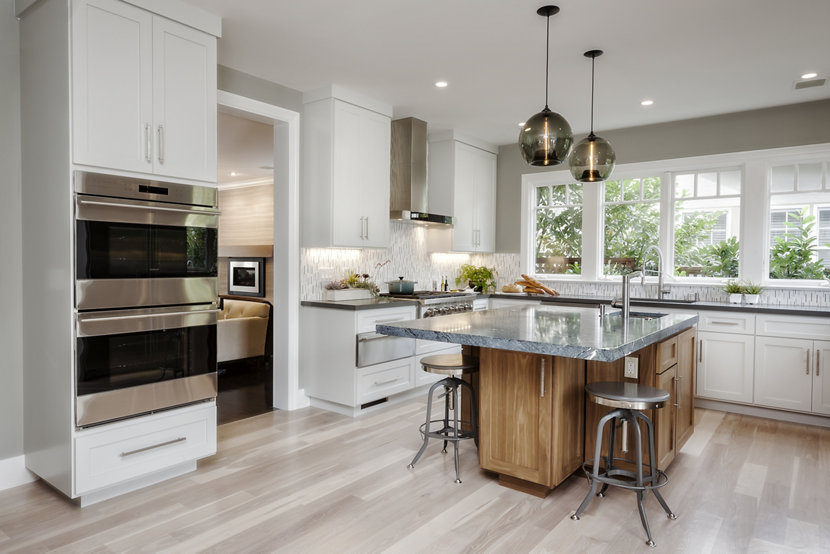 Contemporary kitchen island pendants spotted in california home two stamen pendants in gray glass hang over a kitchen island aloadofball Choice Image