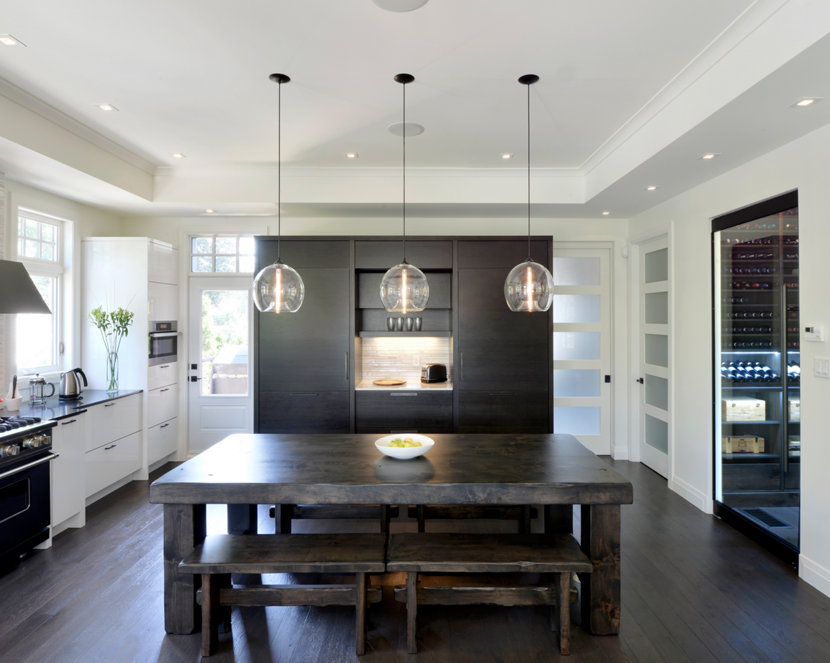 Kitchen Table Lighting Blends Seamlessly With Black And